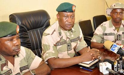 Chief Of Staff, 7div. Brig.-Gen. Enobong Udoh; Director Of Defence Information, Brig.-Gen. Chris Olukolade  and Deputy Director, Army Public Relations, Col. Mohammed Dole during a news conference on the attack of GOC. 7div. Maj.-Gen.  Ahmed Mohammed by soldiers under his command in Maiduguri On  Thursday (15/5/14).