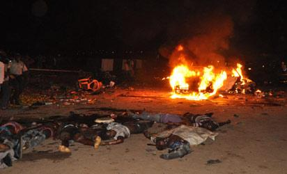 THE BLAST —Scene of the blast in Abuja, yesterday. Photos: Emma Ujah & Gbemiga Olamikan.
