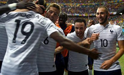 France celebrates after scoring a goal against Nigeria at Brazil 2014.