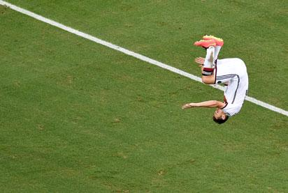 Germany's forward Miroslav Klose celebrates after scoring during a Group G football match between Germany and Ghana at the Castelao Stadium in Fortaleza during the 2014 FIFA World Cup on June 21, 2014.   AFP PHOTO/ POOL/ FRANCOIS XAVIER MARIT