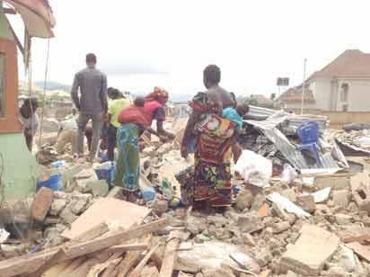 Indigenes picking what remained of their belongings after the latest demolition