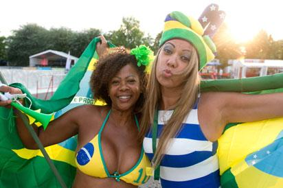: Fans Arlete (L) and Vana pose with a Brazilian flag prior to the 2014 FIFA World Cup opening match Brazil vs Croatia in Heilbronn, Germany, on June 12, 2014. AFP PHOTO / DPA / SEBASTIAN KAHNERT +++ GERMANY OUT