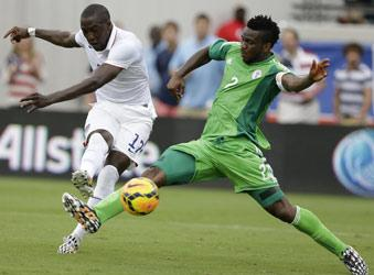 UNITED STATES, JACKSONVILLE : JACKSONVILLE, FL - Forward Jozy Altidore #17 of the United States shoots and scores his second game of the game behind defender Joseph Yobo #2 of Nigeria during the international friendly match at EverBank Field on June 7, 2014 in Jacksonville, Florida. AFP