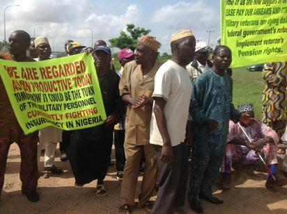 Retired Military men protesting at the Confab