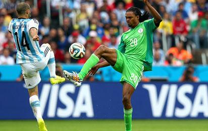 - JUNE 25: Javier Mascherano of Argentina vies with Okechukwu Uchebo of Nigeria during the 2014 FIFA World Cup Brazil Group F match between Nigeria and Argentina at Estadio Beira-Rio on June 25, 2014 in Porto Alegre, Brazil.  Photo: FIFIA
