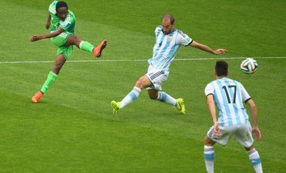Ahmed Musa of Nigeria shoots and scores his team's first goal against Pablo Zabaleta of Argentina during the 2014 FIFA World Cup Brazil Group F match between Nigeria and Argentina at Estadio Beira-Rio on June 25, 2014 in Porto Alegre, Brazil. (Photo by FIFA)