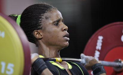 •Golden lift... Amahala lifts for gold in Glassgow Friday. Photos: AFP