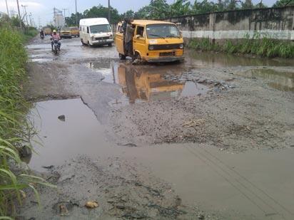 Failed portion of Ajegunle link road to Oshodi-Apapa Expressway