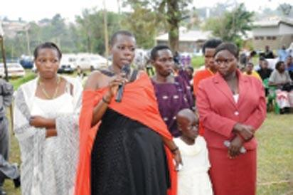 Gloria Tumwijuke (with microphone), Alice Ngonzi Isoke (folding hands in red dress), Diana Alinaitwe (behind Alice), Mrs Isoke (Alice's mother), an unidentified health worker(on Gloria's right) and a granddaughter to Mrs Isoke – all Ebola survivors narrating their ordeal at Kagaadi Hospital during the function to officially declare Uganda Ebola free. Photo courtesy WHO