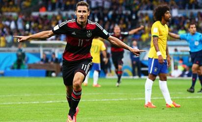 Miroslav Klose of Germany celebrates scoring his team's second goal during the 2014 FIFA World Cup Brazil Semi Final match between Brazil and Germany at Estadio Mineirao on July 8, 2014 in Belo Horizonte, Brazil. FIFA