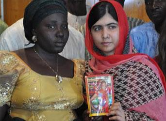 Malala Yousafzai Pakistani with one of the parent of Chibok School girls