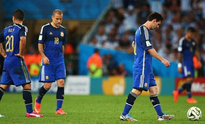 ionel Messi of Argentina (R) looks dejected after a goal during the 2014 FIFA World Cup Brazil Final match between Germany and Argentina at Maracana on July 13, 2014 in Rio de Janeiro, Brazil. (Photo by FIFA
