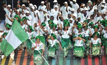 Nigeria's flagbearer Marya Usman leads the delegation during the opening ceremony of the 2014 Commonwealth Games at Celtic Park in Glasgow on July 23, 2014.  AFP PHOTO
