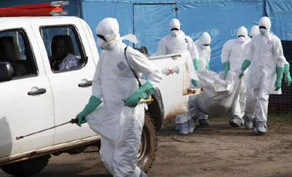 Medical doctors attending to an Ebola virus disease victim