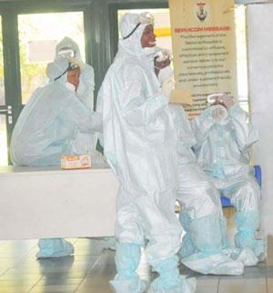 HEALTH PERSONNEL IN PROTECTIVE  KITS AT THE NATIONAL HOSPITAL IN ABUJA ON TUESDAY (12/8/14).