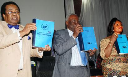 L-r: Deputy Chairman, National Conference, Prof. Bola Akinyemi, Chairman of the Conference, Justice Idris Kutigi(rtd) and the Secretary National Conference, Prof.Valerie  Azinge, displaying the Conference Report, yesterday, at the National Conference in Abuja.