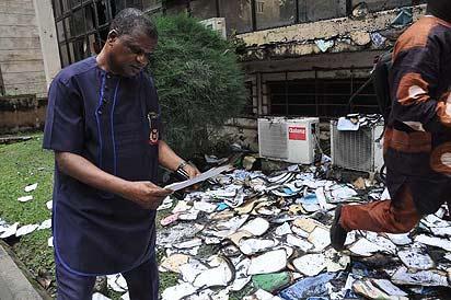 Umeh inspecting burnt documents yesterday.