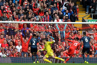 Liverpool's English striker Daniel Sturridge (2nd R) scores his team's second goal past Southampton's English goalkeeper Fraser Forster during the English Premier League football match between Liverpool and Southampton at Anfield stadium in Liverpool, northwest England, on August 17, 2014. Liverpool won the match 2-1. AFP PHOTO/PAUL ELLIS