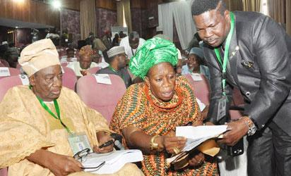 .FROM LEFT:FORMER ATTORNEY GENERAL AND MINISTER OF JUSTICE, JUCTICE RECHARD AKINJIDE;PRESIDENT MARKET WOMEN ASSOCIATION, CHIEF FELICIA SANNI GOING THROUGH DOCUMENT WITH HUMAN RIGHTS LAWYER, MIKE OZEKHOME (SAN) AT THE NATIONAL CONFERENCE IN ABUJA ON WEDNESDAY (13/8/14).