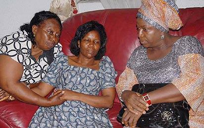 tears for dimgba: Mrs Neta Nwosu (left) and another sympathiser consoling Mrs Obioma Igwe (centre), widow of Late Dimgba Igwe, Vice Chairman, The Sun newspaper at their Okota, Lagos residence, yesterday.