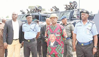 Governor Governor Willie Obiano of Anambra State (2nd right); outgoing state Commissioner of Police, AIG Usman Gwary; Special Adviser on Security, Mr Chikaodi Anambra and DCP Adeoye Finihan during the presentation of three refurbished Armoured Personnel Carriers to Anambra State Police Command at Governor's Lodge, Amawbia, Anambra State.