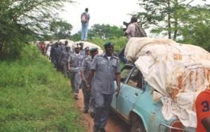 The Customs Area Controller (CAC), Oyo/Osun Command of Nigeria Customs Service (NCS), Mr. Oteri Richard, in front leading other Customs officers into Agbaja forest, during inspection of the seizures of 40 vehicles loaded with rice, intercepted in the forest by his Command.