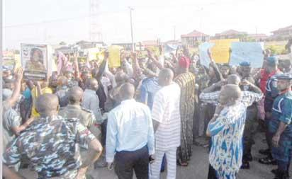 Irate traders protesting the invasion of the market by council officials. I