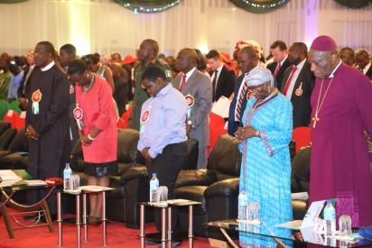 Show From left President Goodluck Jonathan his Daughter Aruera, Jonathan, his Son Abobo Jonathan ,, the President Mother Mrs Eunice Jonathan  and Most Rev, Joseph Efobi  at the Presidential Xmas Carol at the State House Abuja Yesterday STATE HOUS