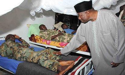 PRESIDENT GOODLUCK JONATHAN CONSOLIG SOME PATIENTS DURING HIS VISIT TO 7 DIVISION MEDICAL SERVICE AND HOSPITAL MAIDUGURI ON THURSDAY (15/1/15)