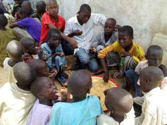 *Displaced children scrambling for food at an IDPs camp in Maiduguri... How safe are they?