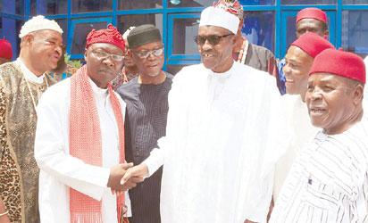 APC Presidential Campaign Candidate, General Muhammadu Buhari, (middle) flanked by APC National Chairman, All Progressive Congress (APC), Chief John Odigie Oyegun, APC Chieftain and former Goverinor, Chief Ogbonnaya Ono, Eze Ndi Igbo Suleja, Amb (Dr.) Igwe Collins Chibueze Okoli, Uche Eginti Eze Udo, President General Igbo delegates Assembly (IDA) of the19 Northern States, Chief Damian Sunny Inyamah and others adopt GEN Muhammadu Buhari for 2015 Presidency at the APC Presidential Campaign office in Abuja. PHOTO; SUNDAY AGHAEZE