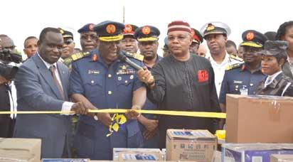 L-R: Director General, NAFDAC, Dr. Paul Orhii, with the Chief of Defence Staff, Chief Marshall Alex Badeh and President of the Association of Pharmaceutical Importers of Nigeria, APIN, Pharm Nnamdi Obi, during the official hand over of drugs and foodstuff valued at N70 million donated by APIN  to the Armed Forces of Nigeria, AFN, in Lagos recently.