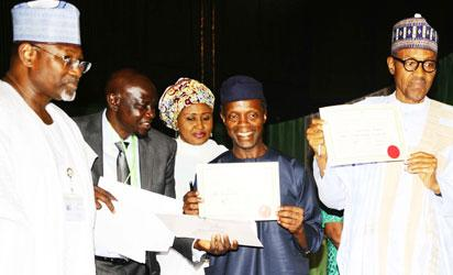 President-Elect, General Muhammadu Buhari (right); his Vice President-Elect, Professor Yemi Osinbajo (2nd right) displaying their Certificates of Return after receiving it from the Chairman, Independent National Electoral Commission (INEC), Professor Attahiru Jega (left) at the National Conference Centre, Abuja on Wednesday