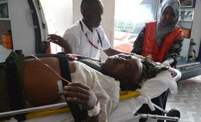 A victim of the attack on a Kenyan university, the Garissa University College campus in north eastern Kenya, arrives at the Kenyatta hospital, on April 2, 2015 in Nairobi. Al-Shebab Islamist militant gunmen seized Christian hostages at the university near the border with Somalia, in an pre-dawn attack that killed at least 15 people and wounded scores more. A spokesman for Somalia's Al-Qaeda-linked Shebab, told AFP the group was behind the early morning assault on the university in Garissa and had taken non-Muslims hostage. AFP PHOTO