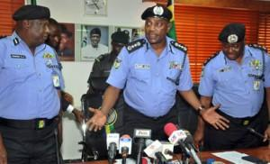 File: Acting Inspector General of Police Solomon Arase (middle) discussing with his Deputy Inspector General of Police Hashimu (left) and  DIG Doma (right)  shortly After handing Over in Abuja Yesterday. Photo by Gbemiga  Olamikan