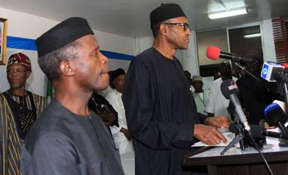 """Nigerian president-elect Muhammadu Buhari (C) delivers a speech in Abuja on April 1, 2015. Nigeria's new president-elect Muhammadu Buhari hailed polls that will lead to the first democratic change of power in Africa's most populous nation as """"historic"""" hours after he secured a decisive victory. AFP PHOTO"""