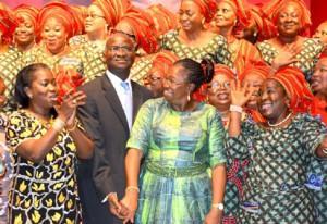 Author, Gbemi Sasore (l) Gov. Fashola and wife, Abimbola at the event