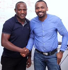 HANDS OF FELLOWSHIP  . . . Shina Philips, CEO Matchmakers and Bassey Eyo, CEO Payporte