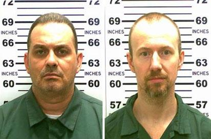 (FILES) This file combination of booking photos received on June 7, 2015, courtesy of the office of New York Governor Andrew Cuomo, shows convicted murderers Richard Matt(L) and David Sweat. Richard Matt, 49, who broke out of a maximum-security New York prison three weeks ago was shot dead by authorities on June 26, 2015, police said, as they continued to hunt for his fellow escapee. New York State Police Superintendent Joseph D'Amico said authorities found Matt near a cabin after he apparently had fired at a passing camper van.
