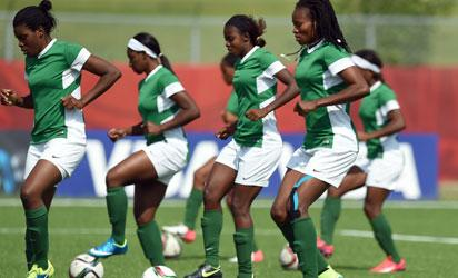 Nigeria's soccer team players run with balls during a training session at the Waverley Soccer Complex in Winnipeg, Manitoba, on June 9, 2015, ahead of their 2015 FIFA Women's World Cup group D football match against Australia to be played on June 12. AFP PHOTO