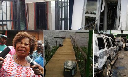 Top: Entrances of the banks burst by the armed robbers. Below from left: A victim agonises over her loss; the exit route of the robbers and some of the cars destroyed during the Ikorodu robbery incident, yesterday. Photos: Bose Adelaja.