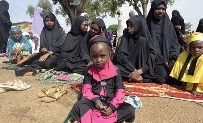 Muslim women and girls attend Eid al-Fitr prayers at the Isa Kazaure praying ground in Nigeria's central city of Jos to mark the end of the Muslim fasting month of Ramadan on July 17, 2015. AFP PHOTO