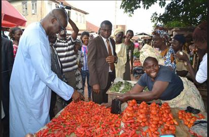 File: Gov Ayo Fayose buying  tomatoes and pepper at a market in Ekiti.