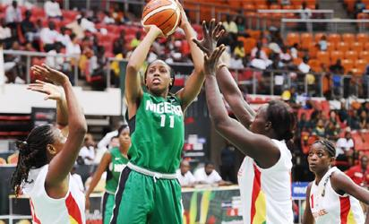 ON TARGET: D'Tigress foward, Adaora Elonu shoots during the match against Guinea yesterday.