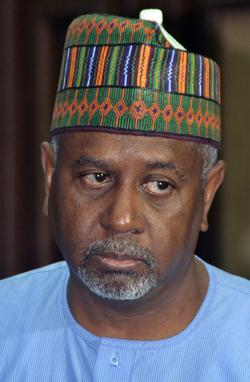 "Former national security adviser of ex-president Goodluck Jonathan, Sambo Dasuki (R), speaks with his lawyer Ahmed Raji, during his trial at the federal high court in Abuja, on September 1, 2015.  Nigerian prosecutors on September 1, 2015 slapped a charge of unlawful possession of arms against Dasuki. Dasuki was arraigned on a ""one-count charge of being in possession of firearms without licence,"" Prosecutor Mohammed Diri told the federal high court in Abuja.  AFP PHOTO"