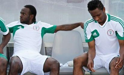 GETTING READY ... Super Eagles duo, Victor Moses (l) and Obi Mikel  on reserve bench in readiness for action.