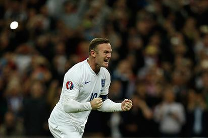 England's striker Wayne Rooney celebrates after scoring from the penalty spot to score his 50th goal for England, making him the country's all-time goal scorer, during the Euro 2016 qualifying group E football match between England and Switzerland at Wembley Stadium in west London on September 8, 2015. AFP PHOTO .