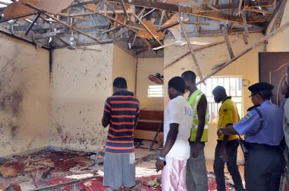 File: A picture taken on October 23, 2015 in Maiduguri, northeast Nigeria, shows people standing in a mosque following a suicide bombing.  At least 53 people were killed in a suicide bombing at a mosque in Maiduguri, northeast Nigeria, on Friday, raising fresh security concerns after a wave of similar attacks. Maiduguri has now been hit six times this month, killing a total of 76 people, according to an AFP tally, underscoring an increased risk to civilians after similar strikes in neighbouring states and near the capital, Abuja. AFP