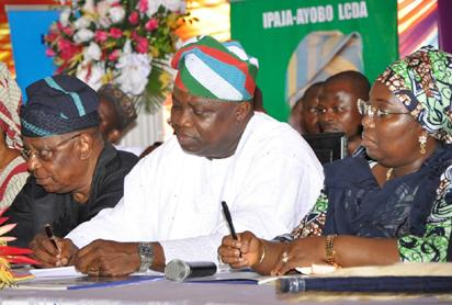 """Governor Akinwunmi Ambode (m); his Deputy, Dr (Mrs) Idiat Adebule (right) taking notes during Ambode's First Quarterly Town Hall Meeting, themed, """"Community Inclusion in Governance,"""" held at the Abesan Mini Stadium, Ayobo-Ipaja, Lagos on Tuesday, October 6, 2015"""
