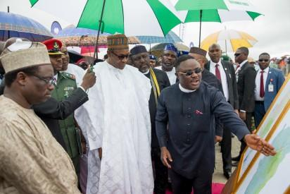 Governor of Calabar Prof. Ben Ayade shows President Buhari the Architectural design/plan during the Ground Breaking Ceremony of 260Km Super Highway Double Carrier Road from Calabar to Northern Nigeria on 20th Oct 2015.
